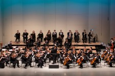 WMU Symphony Orchestra plays on-stage.