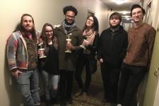 Students Jeff Simmonds, Amber Zundel, Antonio Mitchell, Annie Kustasz, Andrew Paulissen and Josh Moran holding three trophies.