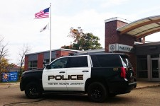 A WMU Department of Public Safety tahoe sits in front of the WMU Police Station.