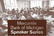 A group of people in a lecture hall. Brown overlay and text that reads: Mercantile Bank of Michigan Breakfast Speaker Series.