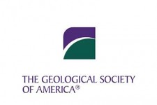 Green and purple logo of the Geological Society of America.