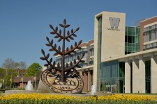 WMU's Sangren Hall and the Gathering Tree sculputre