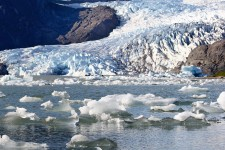 Mendenhall Glacier in Alaska with floating ice blocks in the foreground.