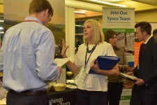 Students and Sysco Corp. reps interact during a marketing career fair.