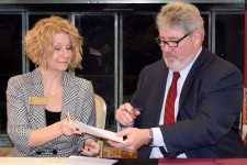 Bott and Quinn signing the accelerated degrees agreement.