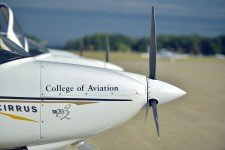 Phoot of the front of an airplane and propeller.