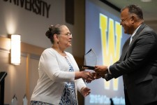 Diana Hernandez receives her Distinguished Service award from WMU President Edward Montgomery