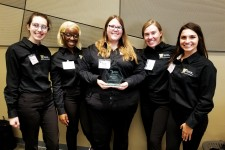 Left to right: Holly Harmon, Raven Lackey, Sarah Hamilton, Kaylen Glenfield and Christina Raeff stand holding the second place award