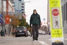 Dr. Ron Van Houten stands in a crosswalk.