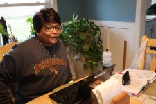 Lucinda Stinson teaches from her dining room table.