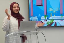 Aisha Thaj gives a presentation to her class.