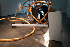A large wooden sculpture in an art gallery.