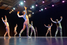 Students dance in a studio.