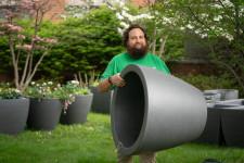 David Prellwitz carries a self-watering planter.