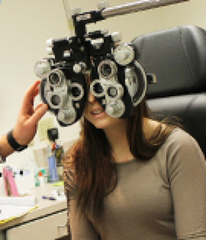 student in vision clinic