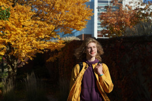 Student walking in the autumn
