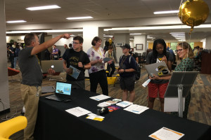 Students talking to librarians at Teaching and Research Technology Day.