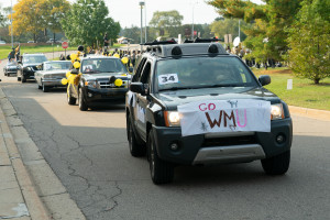 An SUV with a sign that reads,