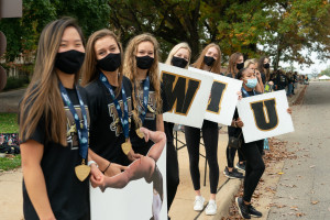 Students hold WMU signs.