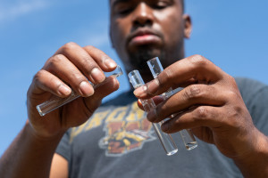 A student pours water into test tubes.