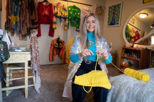 Chloe LePine crochets a garment.