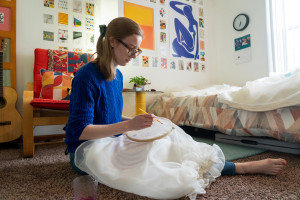 Julia LeKander paints designs on a skirt.