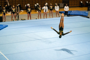Stacie Harrison does a flip on the gymnastics mat.