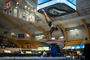 Stacie Harrison flips during a gymnastics competition.