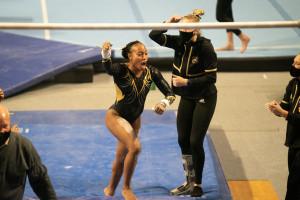 Stacie Harrison raises her arm in celebration.