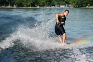 A water skiier spins around on the water.