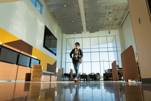 A student walks through the main entrance of the Aviation Education Center.