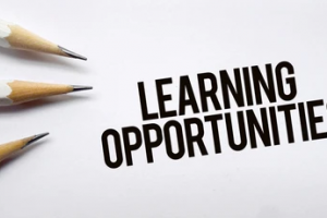 The words learning opportunities next to pencils