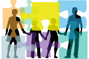 Non-identifiable family holding hands with puzzle piece overlay