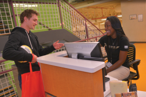 Student and staffer at Student Recreation Center.