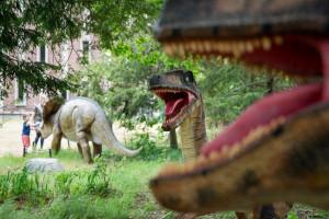 Dinosaur statues on the grass near Rood Hall.