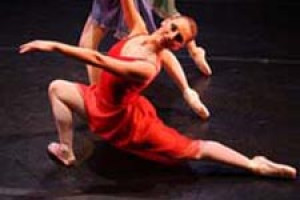 A woman in red dancing.