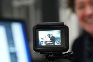 A professor films herself teaching a distance learning class.