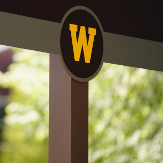 A sign with WMU's logo on it.