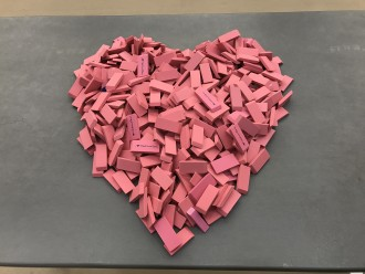 A heart made out of a pile of erasers.