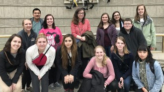 A group of honors students in front of the Charles Wright Museum.