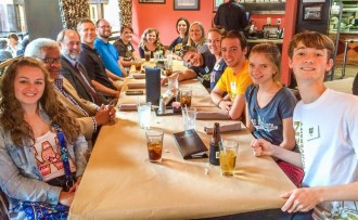 Students having lunch with an alumnus while on the Disney Study in the States trip.