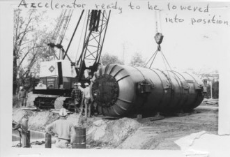 Accelerator ready to be lowered into position.