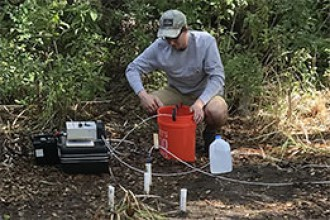 Graduate student Tanten Buszka works in the tracer field