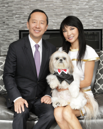 Pictured are Charles Zhang and Lynn Chen-Zhang with dog