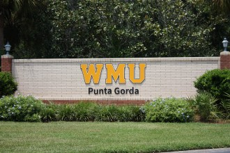 partial brick wall at WMU-Punta Gorda entrace with embossed WMU Punta Gorda.