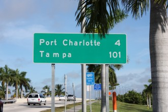 road sign indicating Port Charlotte is 4 miles away and Tampa 101.