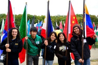 students holding up flags of their countries