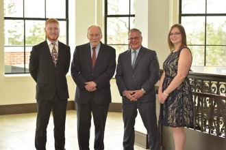Two capital interns with professor Houghton and alumnus Dan Witt