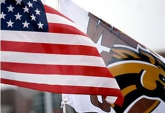 American flag and WMU flag flying on campus
