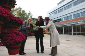 Students looking at a campus map outside